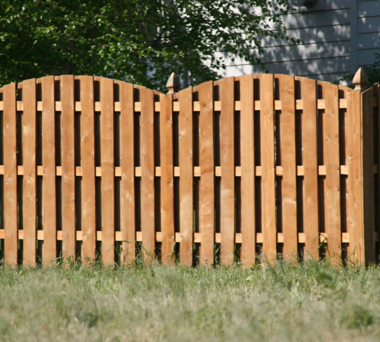 American Fence - Lincoln - Wood Fencing, 1015 6' overscallop board on board stained