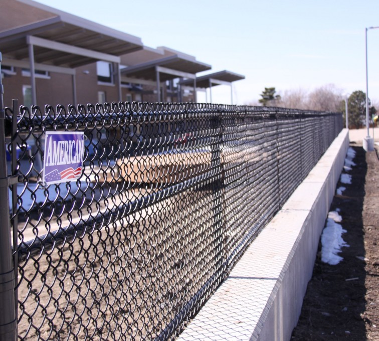 American Fence - Lincoln - Chain Link Fencing, Black Vinyl Chain Link Track Fence