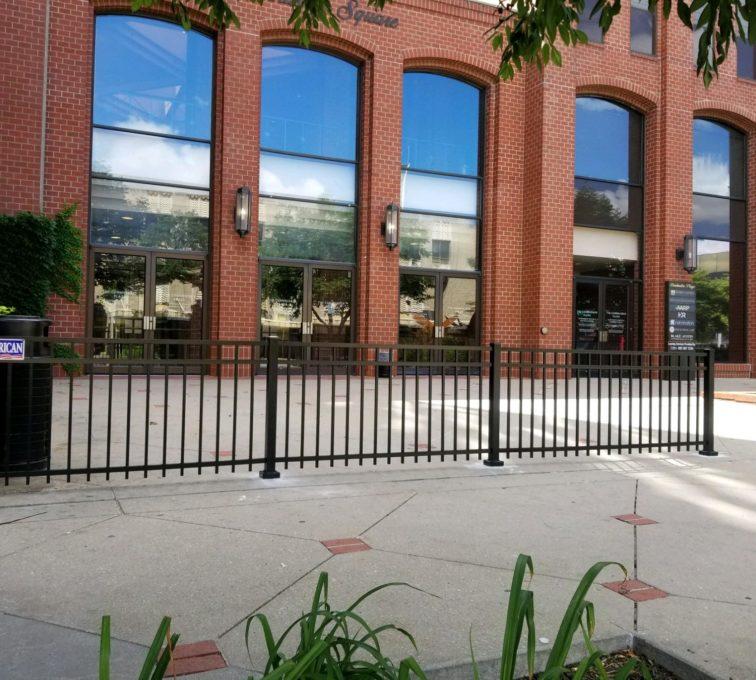 Three panels of 3 rail ornamental iron fence