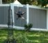 A vinyl privacy fence with white rails and posts with aged cedar-toned pickets