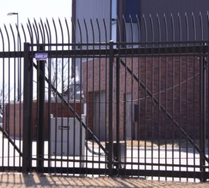 An automated ornamental sliding gate installed by American Fence Company
