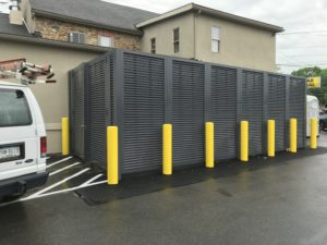 PalmSHIELD horizontal louvered equipment screening installed around an outdoor heating and cooling system