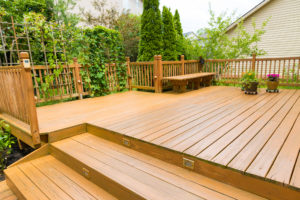 Residential deck covered with greenery and landscaping features